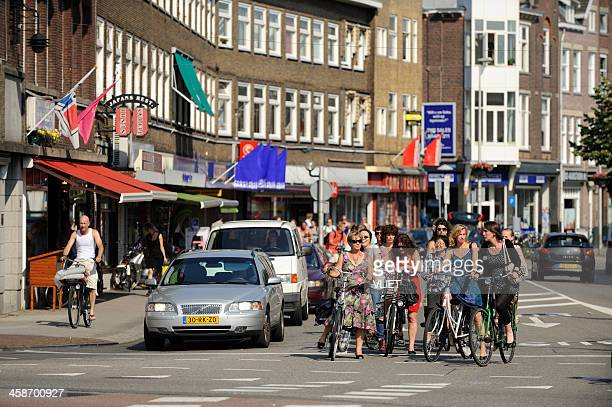 cyclists and cars waiting for the light to turn green - utrecht stock pictures, royalty-free photos & images