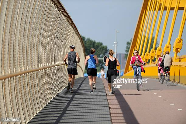 cyclists and exercising runners in utrecht - utrecht stockfoto's en -beelden