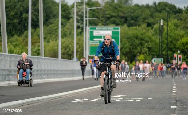Cyclists and pedestrians make their way across the new Northern Spire bridge spanning the River Wear as it opens for a pedestrian walkover on August...
