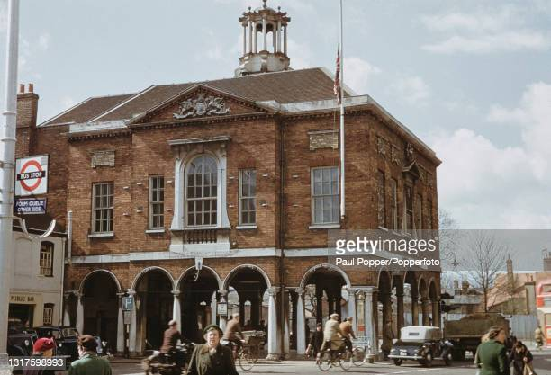 Cyclists and pedestrians make their way past the Guildhall on the High Street in High Wycombe, Buckinghamshire circa 1960.