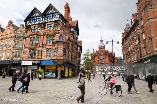 Cyclists and pedestrians traveling around Nottinghams pedestrianised Speakers Corner in Nottingham, Nottinghamshire, United Kingdom. Nottingham city...