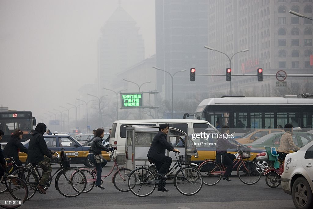 Traffic & Cyclists On Beijing Main Street, China : News Photo