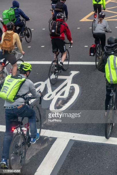 Cyclists are seen commuting on abicycle path as London works towardsgreener communication system England on October8, 2020.