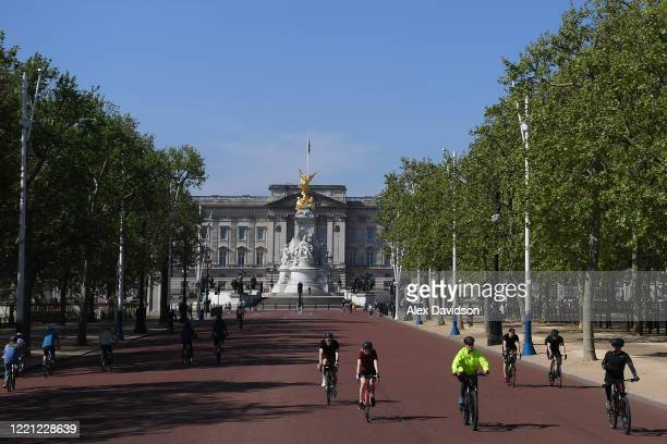 Cyclists are seen on The Mall 3on April 26 2020 in LondonEngland The British government has extended the lockdown restrictions first introduced on...