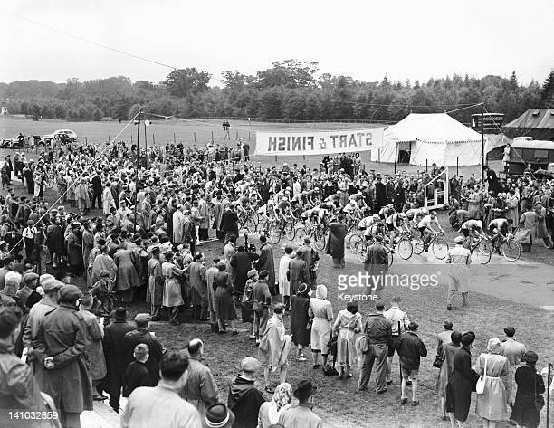 Cyclists at the mass start of one of the men's road races at Smith's Lawn Windsor Great Park during the London Olympic Games 13th August 1948