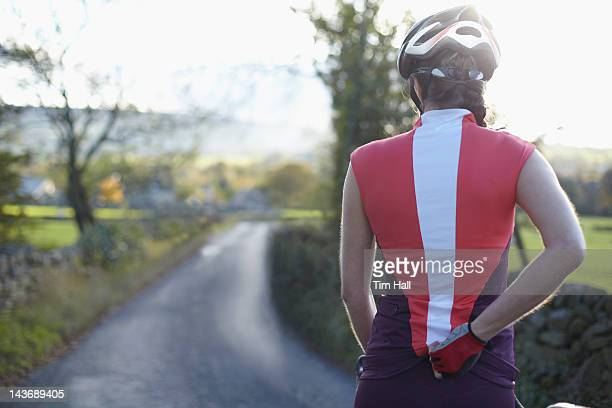 cyclists biking on rural road - cumbria stock photos and pictures
