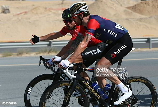 Cyclists Bradely Wiggins of Team Wiggins chats with Mark Cavendish of Dimension Data Team during the second stage of Dubai Tour 2016 in Dubai on...