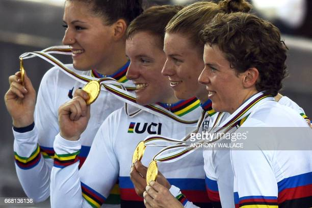 US cyclists Chloe Dygert Kimberly Geist Kelly Catlin and Kimberly Geist and Jennifer Valente celebrate with their gold medals after winning the...