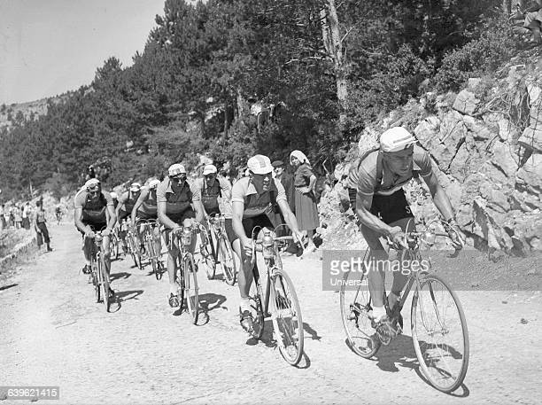 Cyclists climb, for the first time in Tour de France history, the Mount Ventoux on the 17th stage of the 1951 Tour de France. From right to left:...