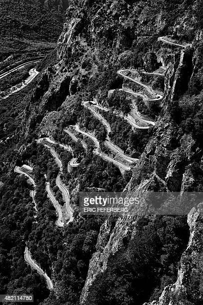 Cyclists climb the Lacets de Montvernier during the 1865 km eighteenth stage of the 102nd edition of the Tour de France cycling race on July 23...