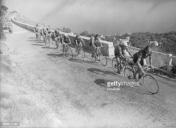 Cyclists climb the road to La Turbie in the 12th stage of the 1952 Tour de France The third racer from the right is Fausto Coppi