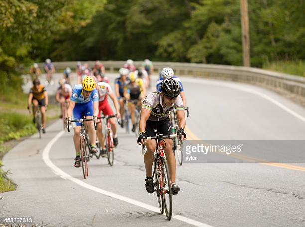 cyclists climbing asteep hill - sponsorship stock pictures, royalty-free photos & images