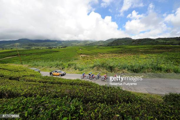 Cyclists compete during stage 5 of the Tour de Singkarak 2017 Solok CitySolok Selatan 1532 km on November 22 2017 in Solok Selatan Indonesia