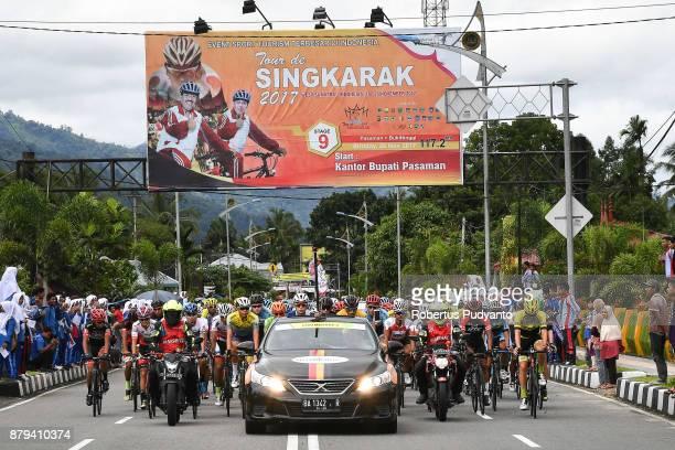 Cyclists compete during stage 9 of the Tour de Singkarak 2017 PasamanBukittinggi 1172 km on November 26 2017 in Bukittinggi Indonesia