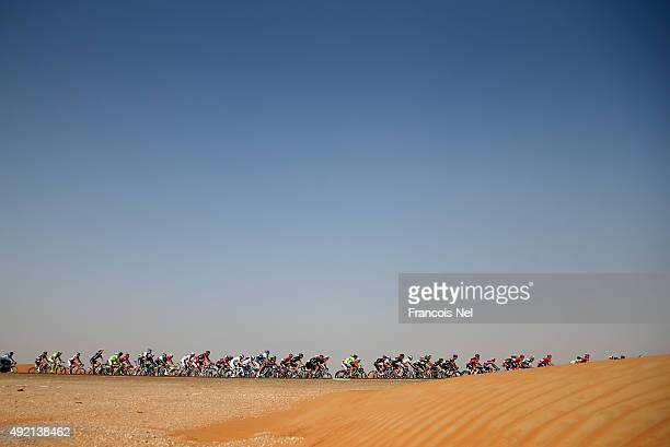 Cyclists compete during stage three of the 2015 Abu Dhabi Tour from Al Qattara Souq to Jebel Hafeet on October 10 2015 in Abu Dhabi United Arab...