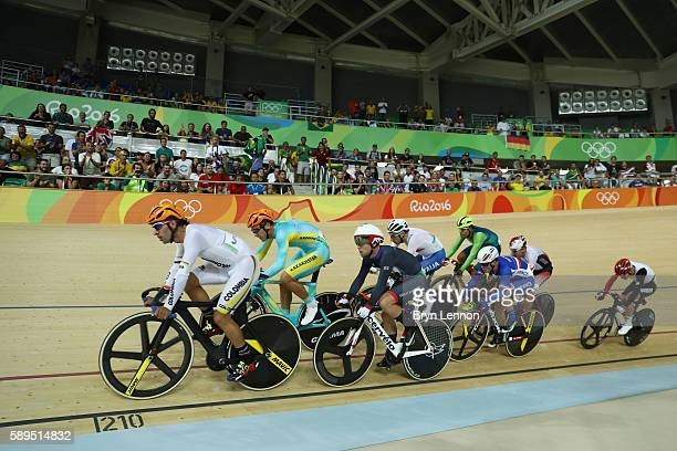 Cyclists compete during the Elimination Race of the Men's Omnium on Day 9 of the Rio 2016 Olympic Games at the Rio Olympic Velodrome on August 14...