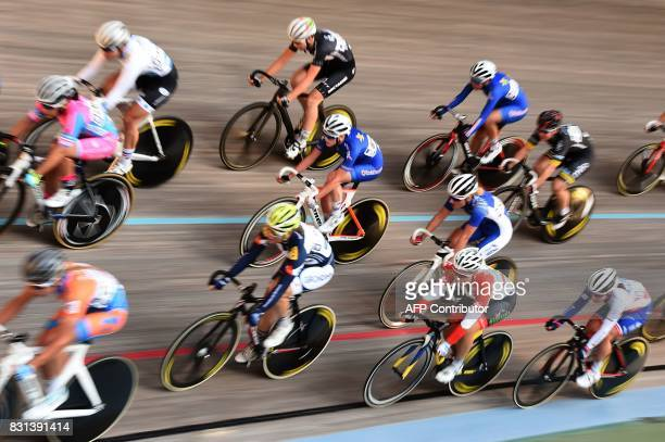 TOPSHOT Cyclists compete during the Scratch Elite final of the French championships on August 14 2017 at the Hyeres' velodrome southern France / AFP...