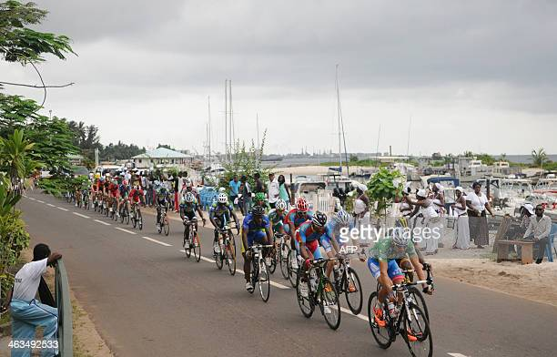 Cyclists compete during the sixth stage of the Tropicale Amissa Bongo 2014 cycling race on January 18 2014 in PortGentil AFP PHOTO SERGE ROGERS