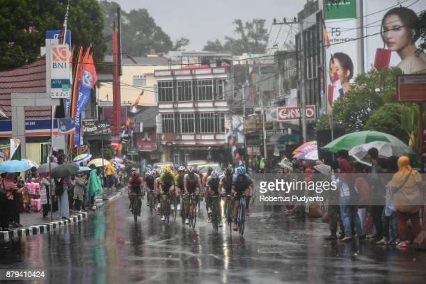 Cyclists compete in heavy rain during stage 9 of the Tour de Singkarak 2017 PasamanBukittinggi 1172 km on November 26 2017 in Bukittinggi Indonesia