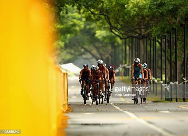 Cyclists compete in the bike leg of the Women's Triathlon on day one of the Youth Olympics at East Coast Park on August 15 2010 in Singapore