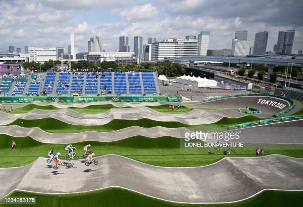 Cyclists compete in the cycling BMX racing men's quarter-finals run at the Ariake Urban Sports Park during the Tokyo 2020 Olympic Games in Tokyo on...