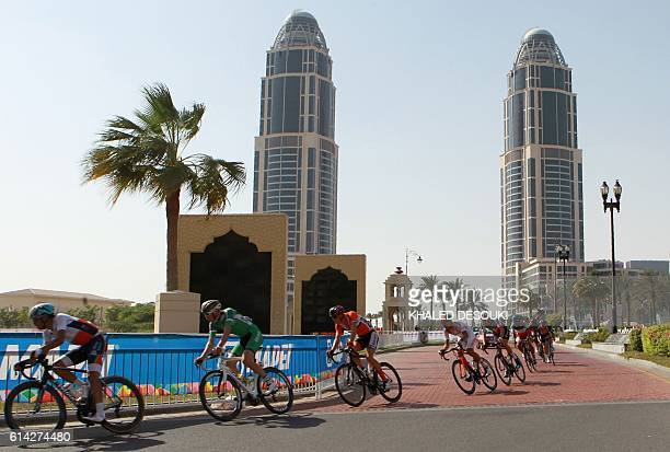 Cyclists compete in the men's under 23 road race event as part of the 2016 UCI Road World Championships on October 13 in the Qatari capital Doha. /...