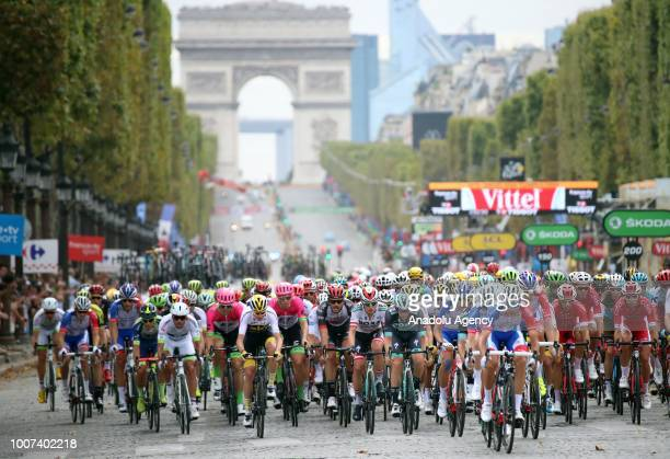 Cyclists compete on the Champs-Elysees avenue at final stage of the Tour de France in Paris, France on July 29, 2018.