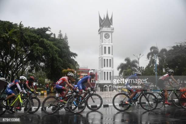 Cyclists compete pass through Jam Gadang in heavy rain during stage 9 of the Tour de Singkarak 2017 PasamanBukittinggi 1172 km on November 26 2017 in...