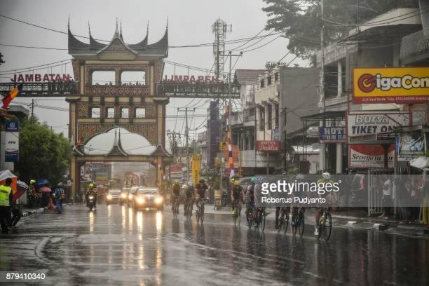 Cyclists compete pass through Jambatan Limpa Peh in heavy rain during stage 9 of the Tour de Singkarak 2017 PasamanBukittinggi 1172 km on November 26...