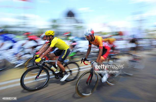 Cyclists compete pass trough Zahir Mosque during Stage 2 of the 2015 Le Tour de Langkawi from Alor Setar to Sungai Petani with a distance of 185 km...