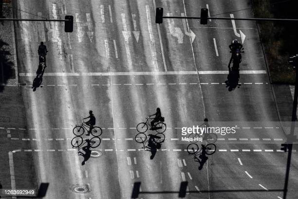 Cyclists cross a road near Potsdamer Platz on July 31 2020 in Berlin Germany Several European countries are exploring how their work force in...