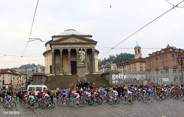 Cyclists cross through Piazza Gran Madre in Torino during the 14th stage of the Tour of Italy cycling race the 206 km leg from Cherasco to Cervinia...