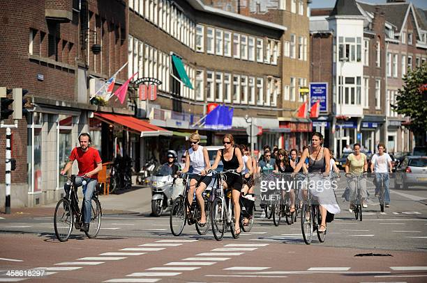 cyclists crossing an intersection in utrecht the netherlands - utrecht stockfoto's en -beelden