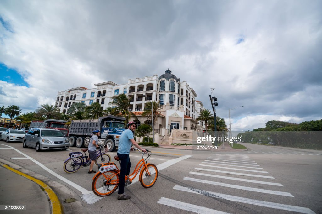 Cyclists crossing street in Boca Raton, USA : Stock Photo