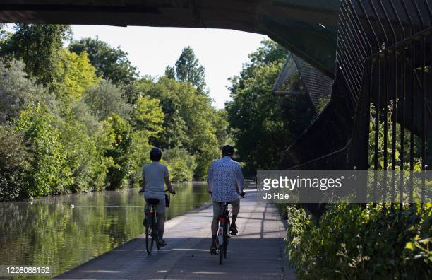 Cyclists cycle by Regent's Canal, Primrose Hill on May 20, 2020 in London. The British government has started easing the lockdown it imposed two...