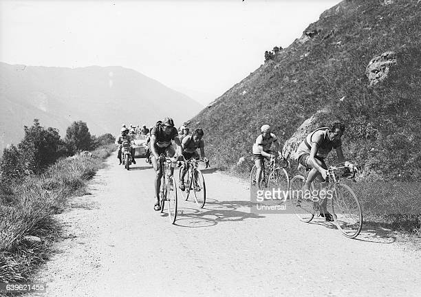 Cyclists Fausto Coppi Lucien Lazarides Apo Lazarides and Jean Robic break away from the pack on Tourmalet's Pass in the 11th stage of the 1949 Tour...