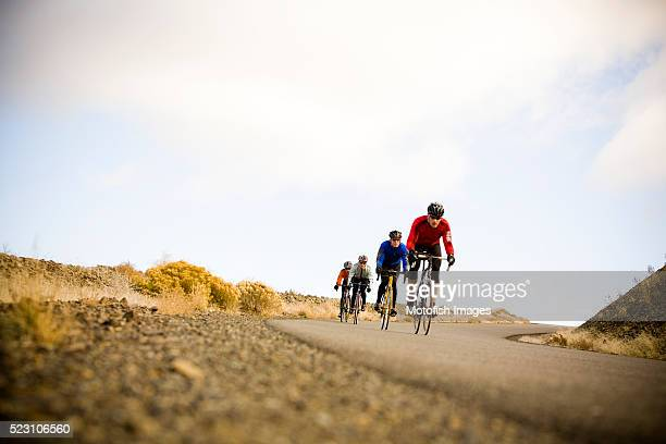 cyclists going downhill - side by side stock pictures, royalty-free photos & images