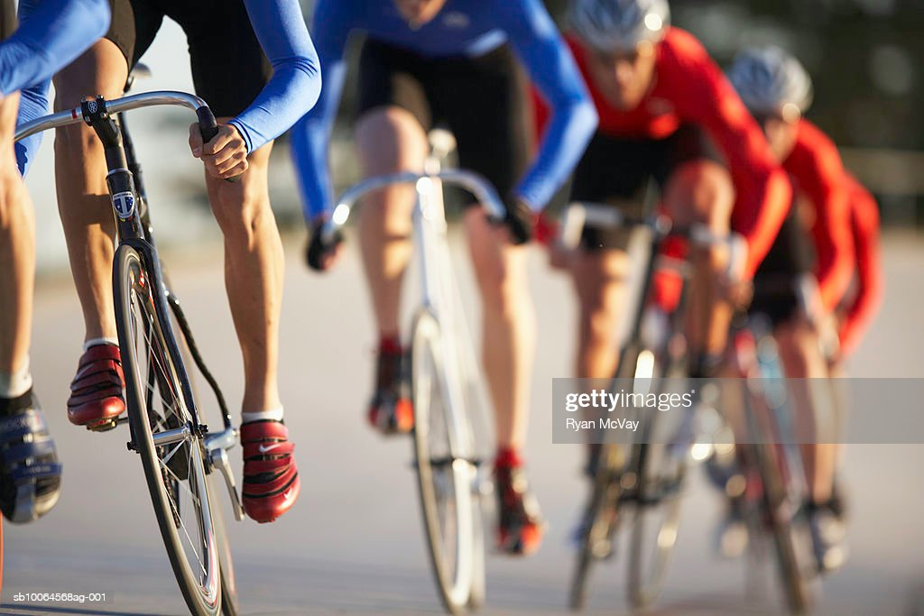 Cyclists in action, low section (focus on foreground) : Stockfoto