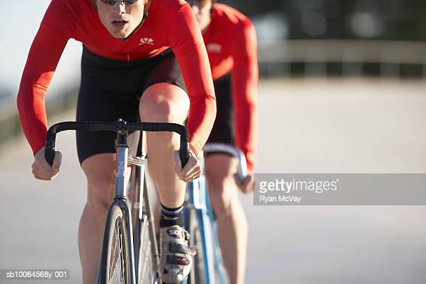 cyclists in action, mid section - track cycling stock pictures, royalty-free photos & images