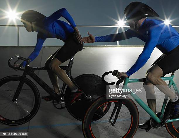 cyclists in action on velodrome track - track cycling stock pictures, royalty-free photos & images