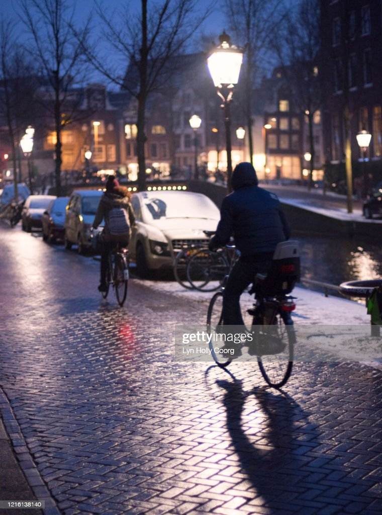 Cyclists in Amsterdam at night : Stock Photo
