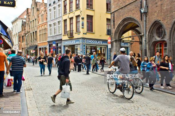 cyclists in bruges - belgium stock pictures, royalty-free photos & images