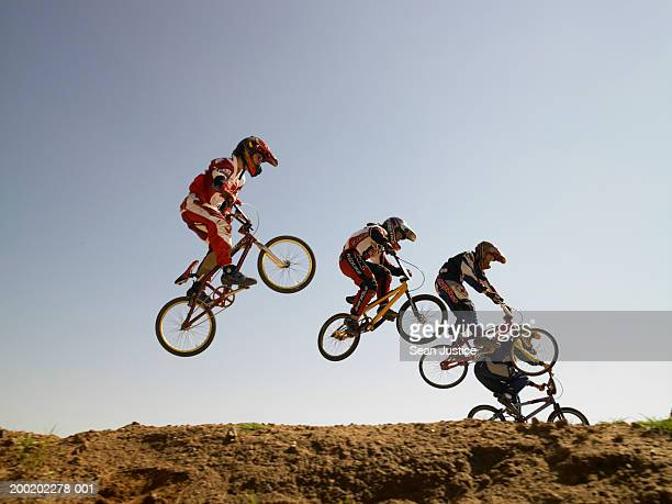 bmx cyclists in competition - bmx cycling stock pictures, royalty-free photos & images