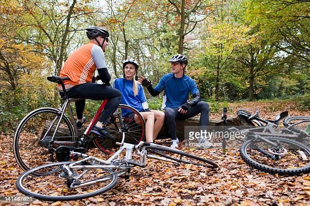 Cyclists in park, taking a break