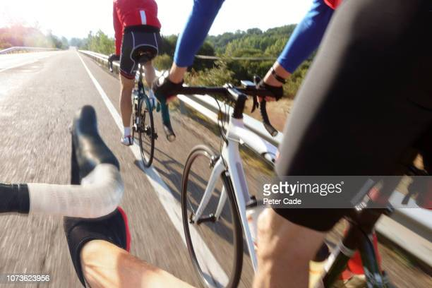 cyclists in road race - road race stock pictures, royalty-free photos & images