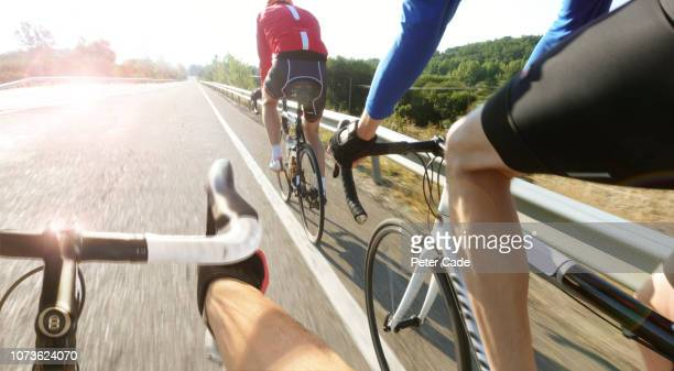 cyclists in road race - chasing stock pictures, royalty-free photos & images