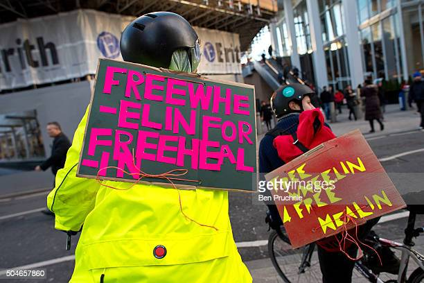 Cyclists in support of the junior doctors wear placards with the slogan 'freewheelin for freehealin' outside Guy's hospital as junior doctors stage a...
