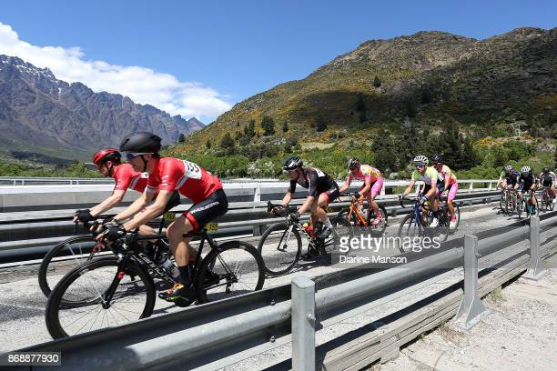 Cyclists in the main peloton make their way over the bridge towards Frankton during stage 3 from Mossburn to Coronet Peak during the 2017 Tour of...