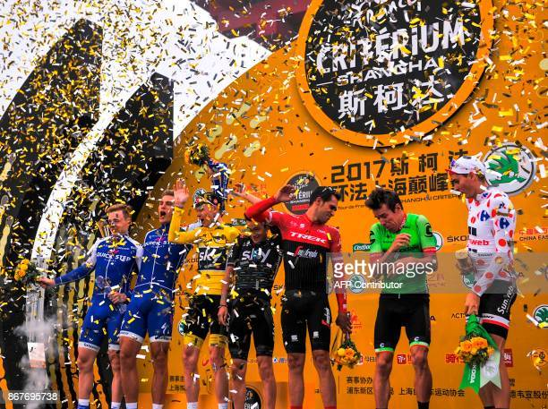 Cyclists including Chris Froome of Britain Alberto Contador of Spain Rigoberto Uran of Colombia and France's Warren Barguil celebrate the end of the...