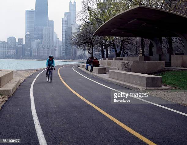 Cyclists inline skaters and skateboarders regularly whiz past the Lincoln Park Chess Pavilion along the Lake Michigan shoreline Chicago Illinois